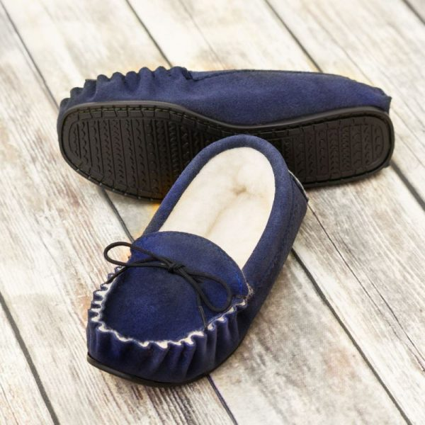 Navy British Made Suede Moccasin Slippers on brown background
