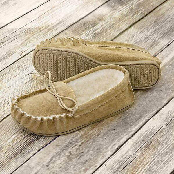 Beige British Made Suede Moccasin Slippers on wooden floor boards