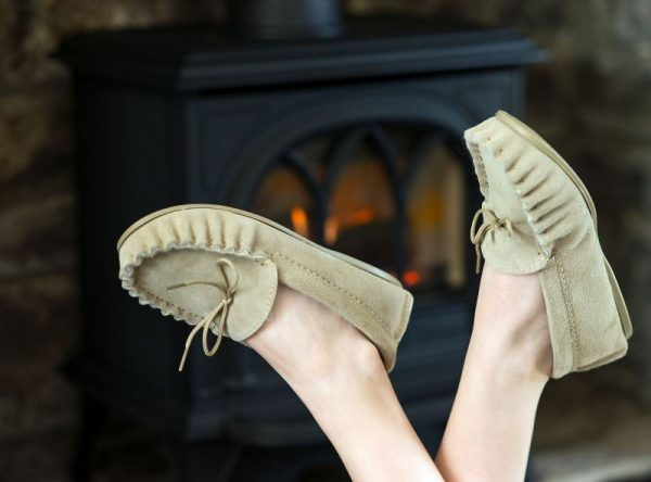 Beige British Made Suede Moccasin Slippers in front of log burner