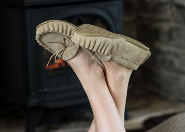 Beige British Made Suede Moccasin Slippers in front of fire place