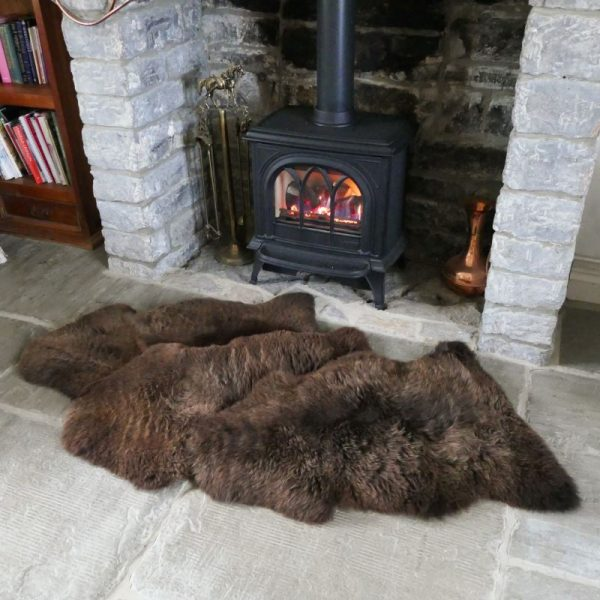 Short Fur Undyed Sheepskin Throw/Rug in front of fire place